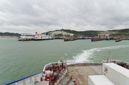 dover: DOVER, ENGLAND - OCTOBER 24, 2015: Ferry boat leaving Dover heading to Dunkirk, France Editorial