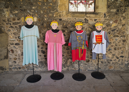 mediaval: CHICHESTER, ENGLAND - OCTOBER 22, 2015: mannequins with mediaval children cloths in the Chichester cathedral