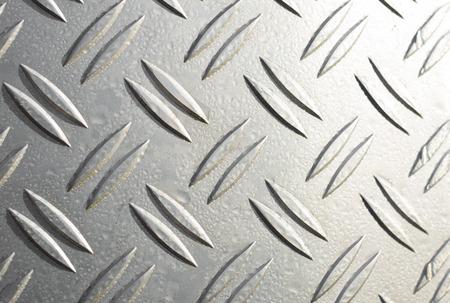 diamond plate: background of a metal diamond plate Stock Photo