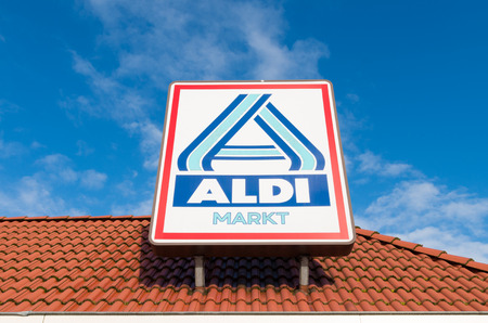 discounted: OLDENZAAL, NETHERLANDS - NOVEMBER 3, 2015: Aldi store logo. Aldi is an internationally operating German chain of discount supermarkets, founded in 1946 in Essen by the brothers Karl and Theo Albrecht Editorial