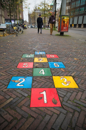 hopscotch: AMSTERDAM, NETHERLANDS - NOVEMBER 15, 2015: Colorful hopscotch game in the streets of amsterdam