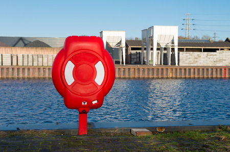 safety buoy: Safety life buoy in red case in a harbor