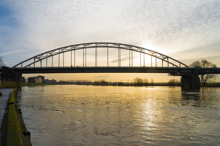 ijssel: steel arch bridge over the IJssel river at Deventer in the netherlands