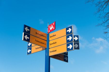 recreational area: pole with lots of directional signs in a recreational area Stock Photo