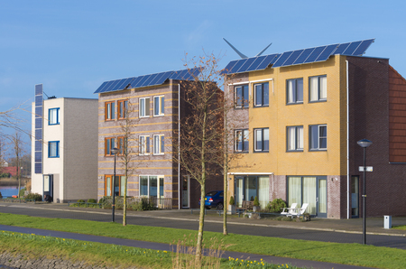 row of newly build modern houses with solar panels in the netherlands 写真素材