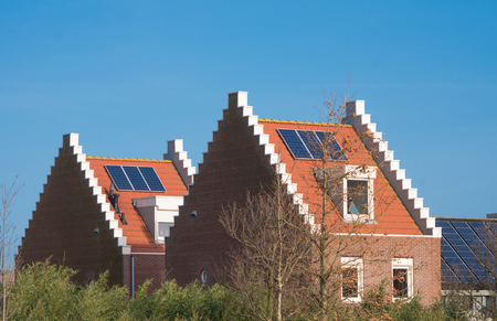 modern houses with solar panels in a residential area in the netherlands
