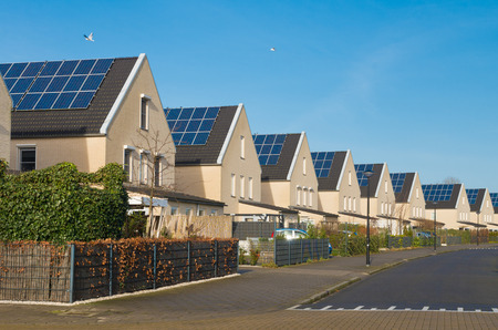 row of newly build modern houses with solar panels in the netherlands Standard-Bild