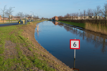 commandment: canal with 6 kmh boat speed sign