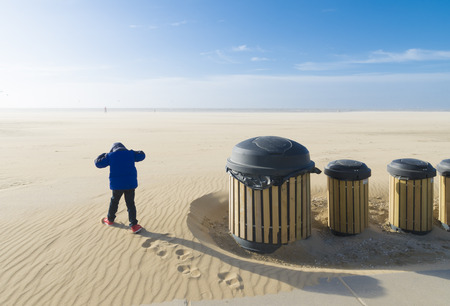 little boy preparing for an upwind run on a desolate beach