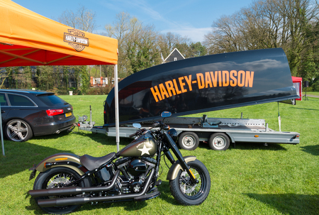 illustrious: OLDENZAAL, NETHERLANDS - APRIL 10, 2016: Harley-Davidson motorbike and custom made trailer on the annual Hulsbeek day in the netherlands Editorial