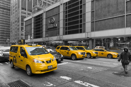 taxicabs: NEW YORK - MAY 3, 2016: Typically yellow medallion taxicabs in front of the New York Hilton. They are widely recognized icons of the city and come in two varieties: yellow and green.