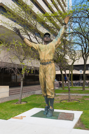 JERSEY CITY, USA - APRIL 27, 2016:  Jackie Robinson statue in Journal square in front of the Path station. It commemorates Jackie Robinson's groundbreaking first major league game at nearby Roosevelt Field
