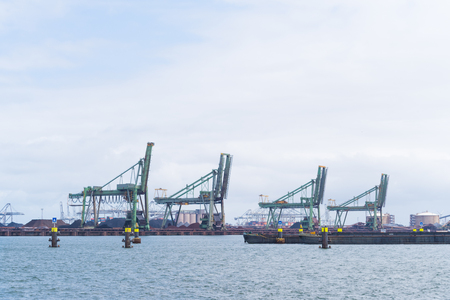 several harbor cranes in the port of rotterdam