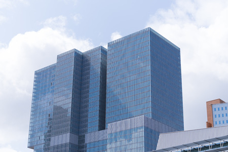 ROTTERDAM, NETHERLANDS - MAY 14, 2016: Low angle view of the famous skyscraper the rotterdam. It is a multifunctional building on the Wilhelmina Pier designed by O.M.A., the office of architect Rem Koolhaas.