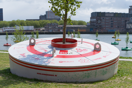 ROTTERDAM, NETHERLANDS - MAY 14, 2016:  Buoy with names of the contributors of the bobbling forest, a collection of buoys with smal elm trees planted in them Editorial