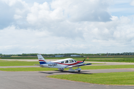 lelystad: LELYSTAD, NETHERLANDS - MAY 15, 2016: Light aircraft taxiing to the runway on Lelystad airport