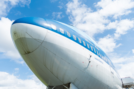 lelystad: LELYSTAD, NETHERLANDS - MAY 15, 2016: Low angle view of a blue KLM 747 jumbo jet at the aviodrome aerospace museum at lelystad airport
