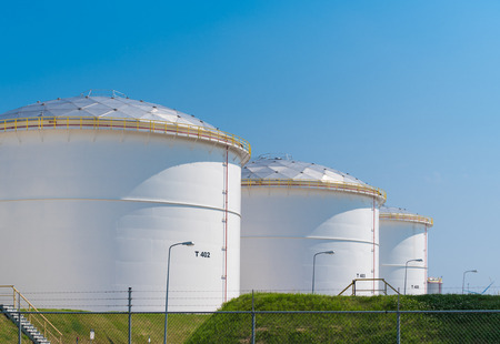 silos: rows of large oil silos in the port of amsterdam Stock Photo