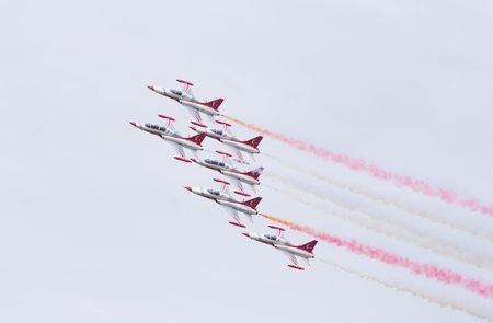 LEEUWARDEN, NETHERLANDS - JUNE 6, 2016: Turkish Star air force demonstration tean performing their stunts during the Dutch Air Force open days