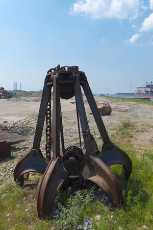 left behind rusty iron stone grabber Stock Photo