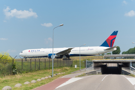 SCHIPHOL, NETHERLANDS - JUNE 4, 2016: Delta airlines plane taxiing to the runway on schiphol airport