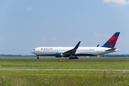 SCHIPHOL, NETHERLANDS - JUNE 4, 2016: Delta airlines plane takes off at amsterdam international airport