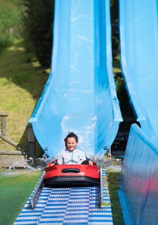 the hague: THE HAGUE, NETHERLANDS - JULI 3, 2016: Girl enjoying a water slide in a theme park in the netherlands