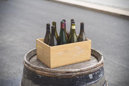 cardboard box with empty wine bottles
