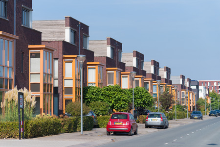 townhouses: LENT, NETHERLANDS - SEPTEMBER 24, 2016: Modern residential area with identical townhouses Editorial