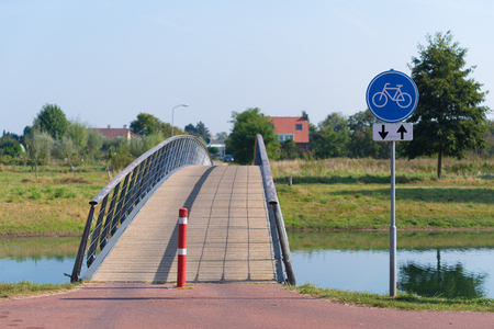 small bicycle bridge over a canal