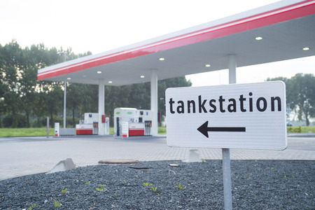 direction shield in front of an unmanned gas station in the netherlands