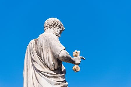 VATICAN CITY, VATICAN - OCTOBER 16, 2016: Statue Saint Peter holding a key in front of St Peters Basilica on piazza San Pietro Stock Photo
