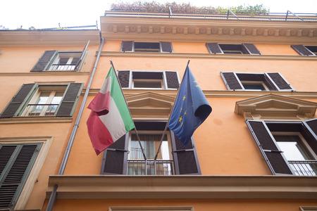 italian national flag and the european flag on a balcony in rome Stock Photo
