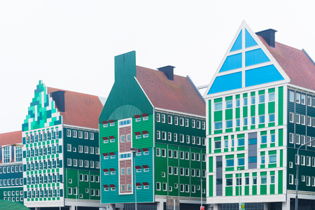 ZAANSTAD, NETHERLANDS - NOVEMBER 13, 2016: Typical facade of the Inntel hotel, opened in 2010. It is an accumulation of almost seventy separate Zaanse houses, executed in four colors Zaans green. Editorial