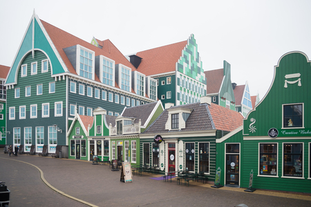 ZAANSTAD, NETHERLANDS - NOVEMBER 13, 2016: Typical facade of the Inntel hotel, opened in 2010. It is an accumulation of almost seventy separate Zaanse houses, executed in four colors Zaans green. 에디토리얼