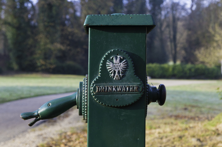 green drinkwater (drinking water) tap in a dutch park Stockfoto