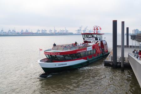 HAMBURG, GERMANY - DECEMBER 20, 2016: Public transportation boat on the Elbe river in the Hamburg port area