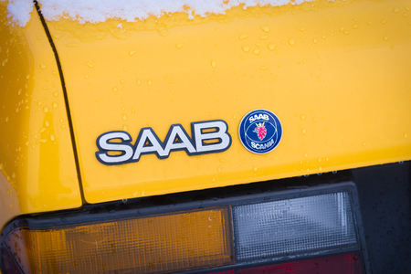 OLDENZAAL, NETHERLANDS - JANUARY 15, 2017: Detail of a yellow vintage Saab 900 turbo S convertible in snowy conditions. 報道画像