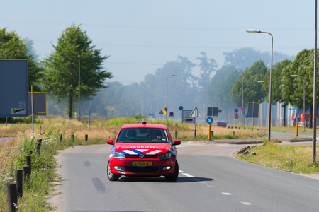 HENGELO, NETHERLANDS - JULY 1, 2018: Fire department commander control car at a large fire Standard-Bild - 106109880