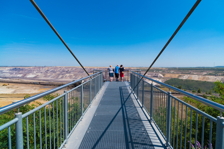 JACKERATH, GERMANY - JULY 7, 2018: Skywalk with unknown people at the Garzweiler open pit brown coal mine