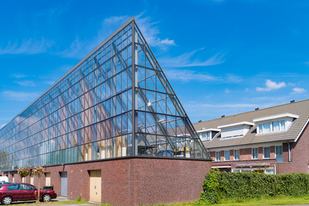 SCHIEDAM, NETHERLANDS - MAY 6, 2017: Transparant garage building with glass roof