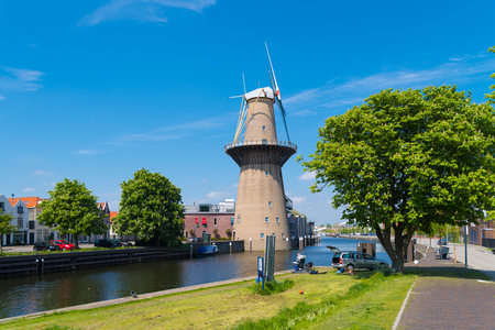 SCHIEDAM, NETHERLANDS - MAY 6, 2017: The Nolet mill, the highest windmill of the world. It generates electricity for the adjacent distillery Banco de Imagens - 107696075