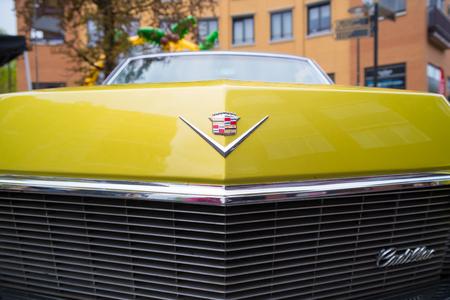 NIJVERDAL, NETHERLANDS - MAY 7, 2017: Cadillac emblem on a yellow oldtimer car Editorial