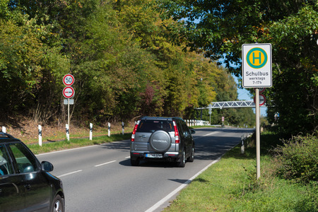 BOTTROP, GERMANY - AUGUST 29, 2018: School bus stop along a busy road Editöryel