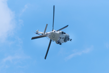 ROTTERDAM, NETHERLANDS - SEPTEMBER 3, 2017: NH90 navy helicopter in action during the Rotterdam port days 에디토리얼