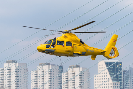 ROTTERDAM, NETHERLANDS - SEPTEMBER 3, 2017: Yellow offshore rescue helicopter doing a demonstration during the Rotterdam world port days Publikacyjne