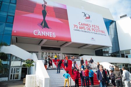 CANNES, FRANCE - OCTOBER 26, 2017: Tourists making pictures on the famous red carpet stair of the Grand Auditorium Louis Lumiere Redakční