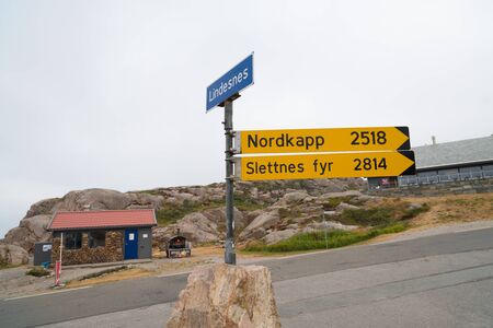 directional sign in norway with the distance to the Nordkapp and the slettnes lighthouse