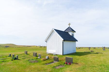 characteristic white chapel belonging to the Varhaug cemetary in Norway Фото со стока