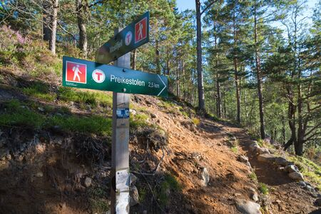 directional sign to the famous preikestolen. Preikestolen or Prekestolen (English: The Pulpit Rock, Pulpit or Preacher's Chair) is a tourist attraction in the municipality of Forsand in Rogaland county, Norway. Stock Photo